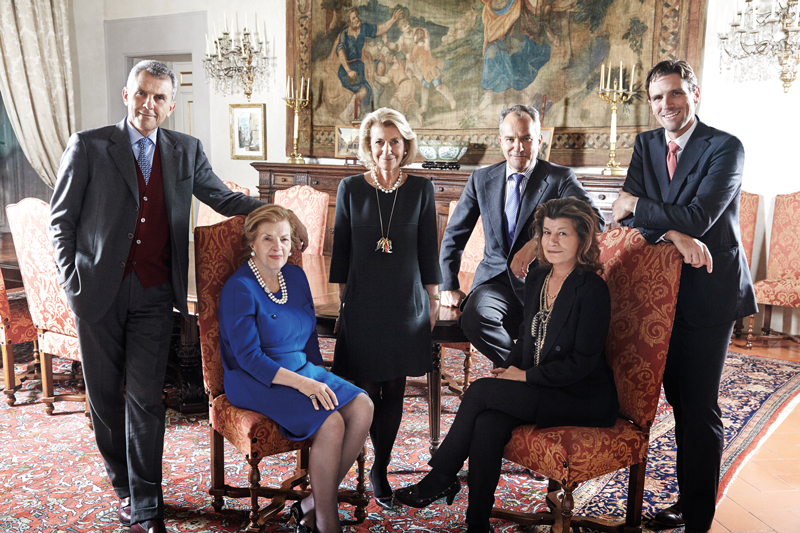 The Ferragamo Dynasty (from left to right): Ferruccio, eldest son and president; Wanda, matriarch and honorary chairwoman; daughter Giovanna, deputy chairwoman who created the women's wear division; Leonardo, CEO of the group's holding company; daughter Fulvia, vice president of the holding company; and grandson James, director of women's and men's shoes and leather goods